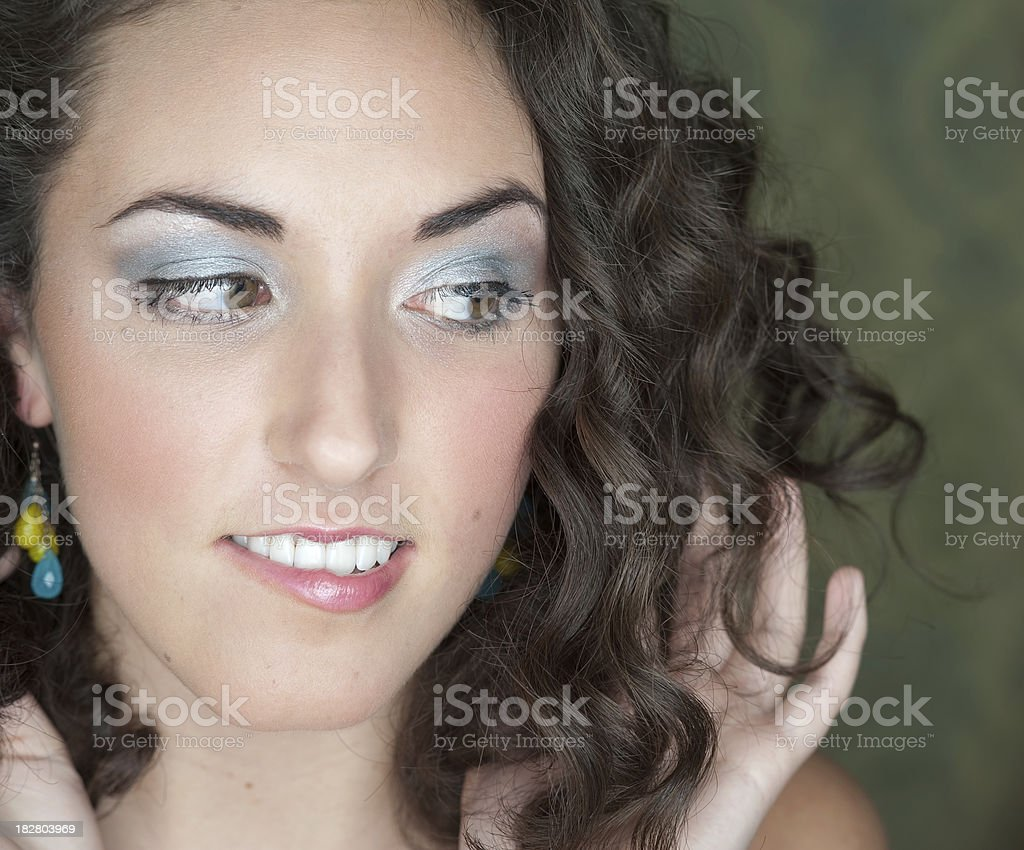 Young woman looking to side and biting lip royalty-free stock photo