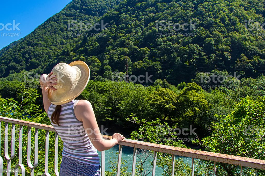 Young woman looking up, from back stock photo