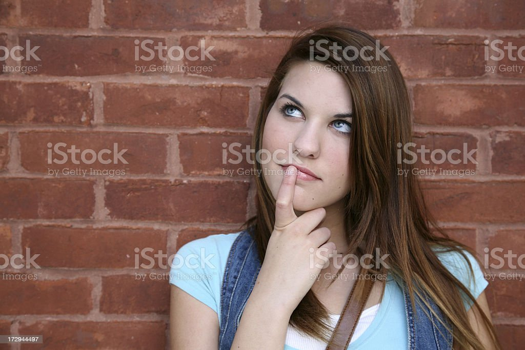 Young Woman Looking Up Into The Sky Daydreaming royalty-free stock photo