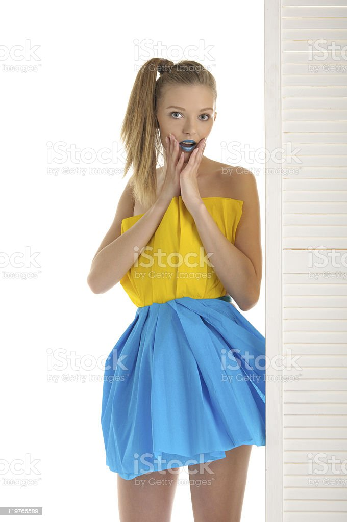 Young woman looks out because of door royalty-free stock photo