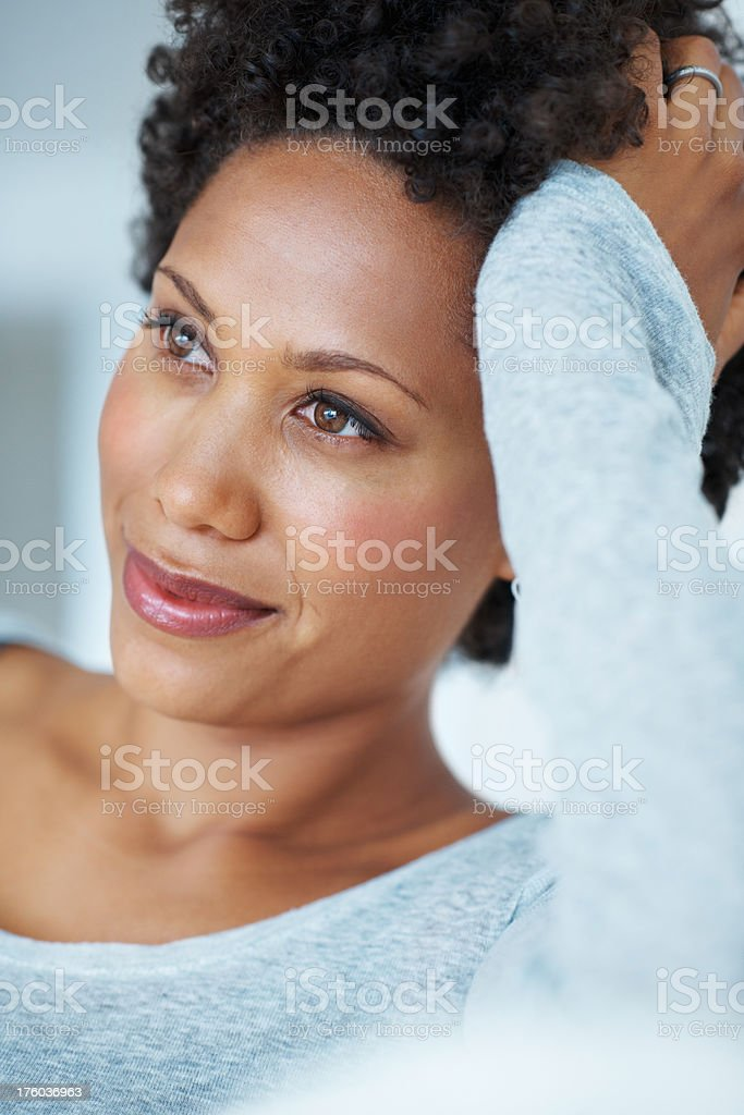 Young woman lost in thought stock photo