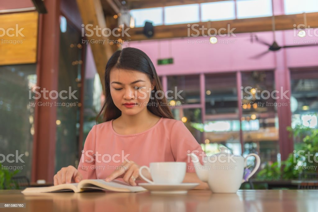 Young woman love reading book and drinking hot tea stock photo