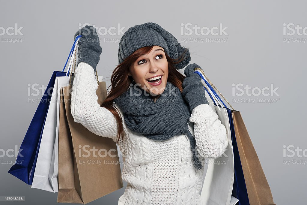Young woman loving winter sale stock photo