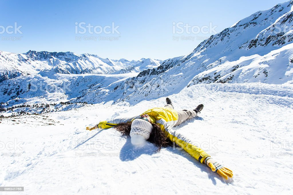 Young woman lying down on the snow stock photo
