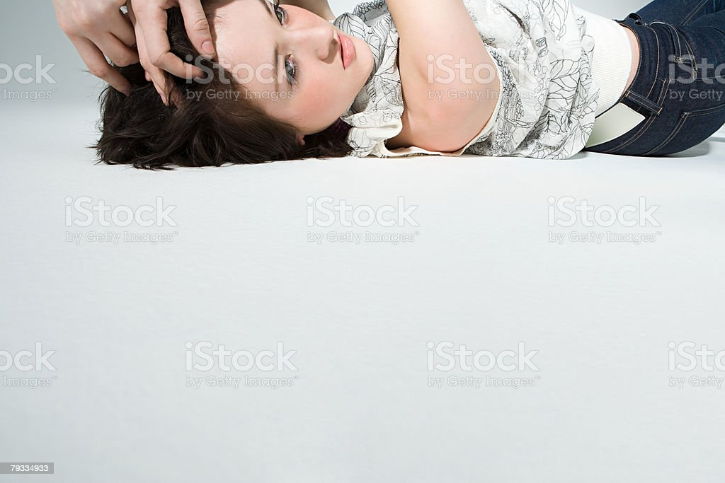Young woman lying down stock photo