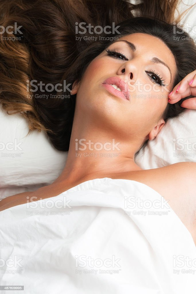 Young woman lying in bed royalty-free stock photo