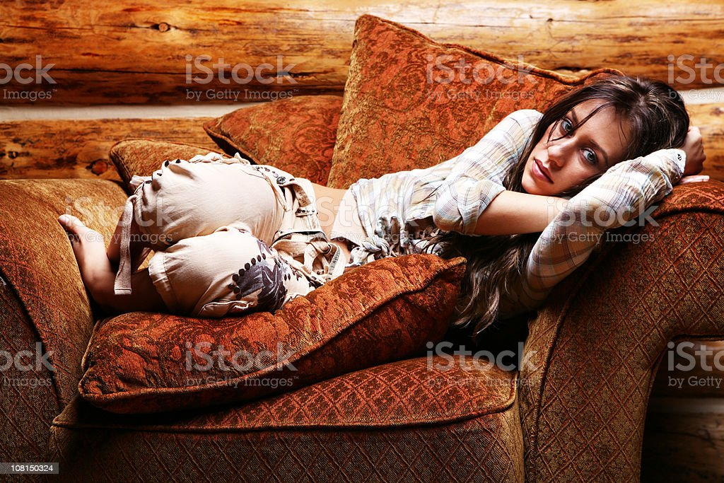 Young Woman Lying in Big Chair royalty-free stock photo