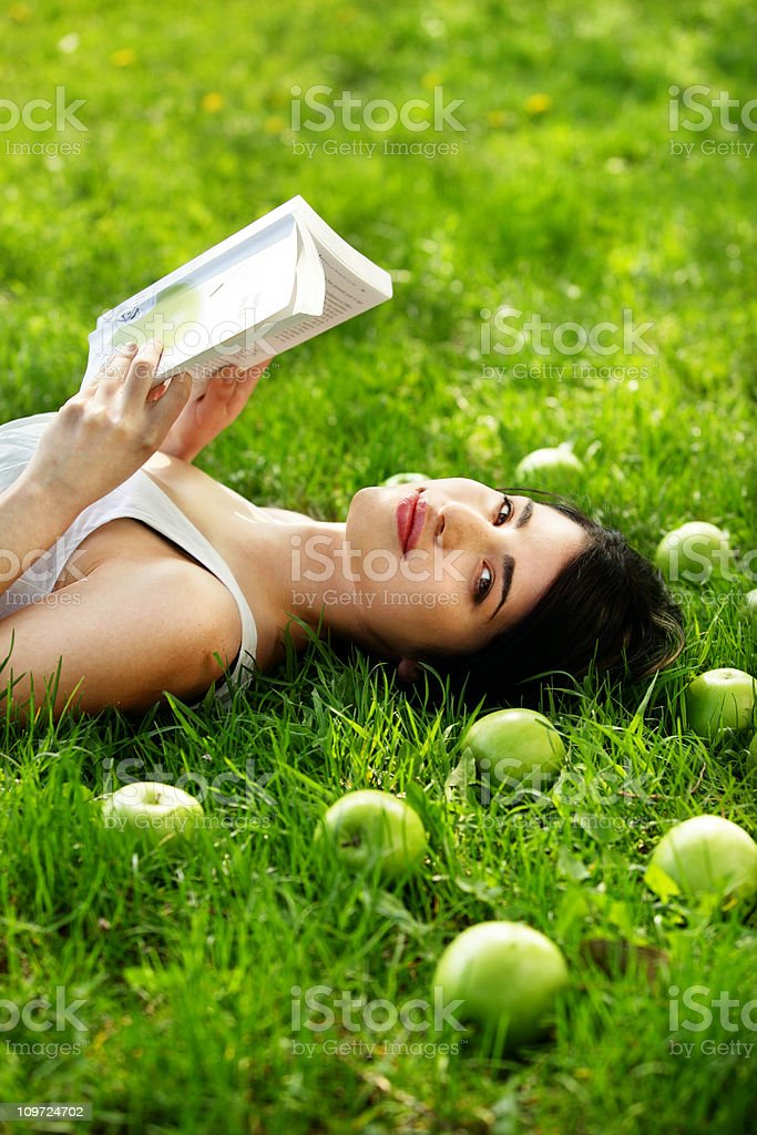 Young Woman Lying in Grass royalty-free stock photo