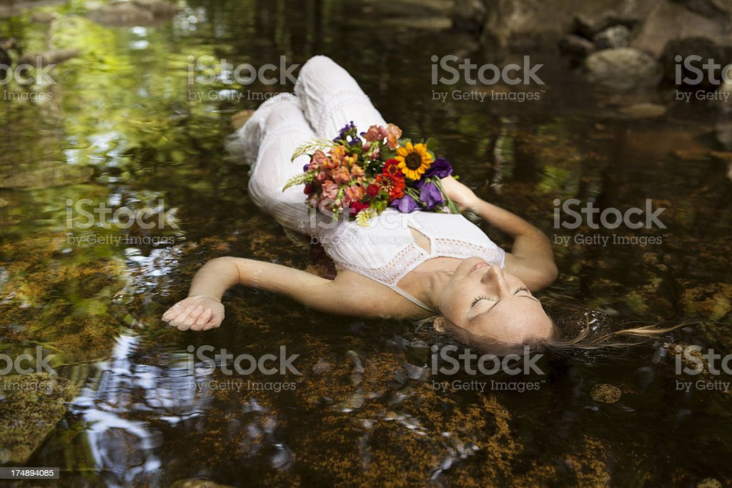 young woman lying in water stock photo