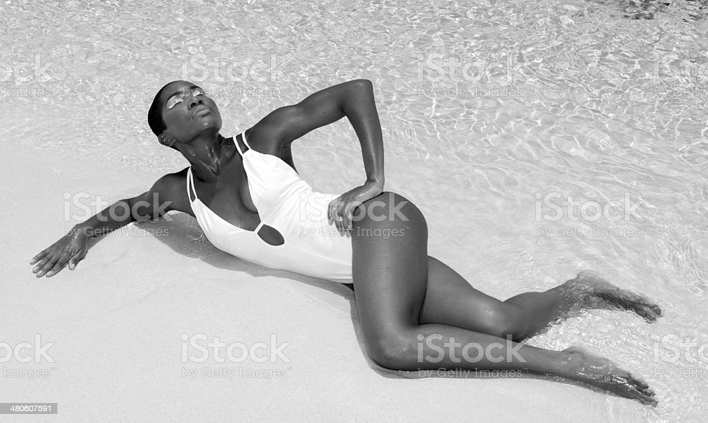 Young Woman Lying On A Beach royalty-free stock photo