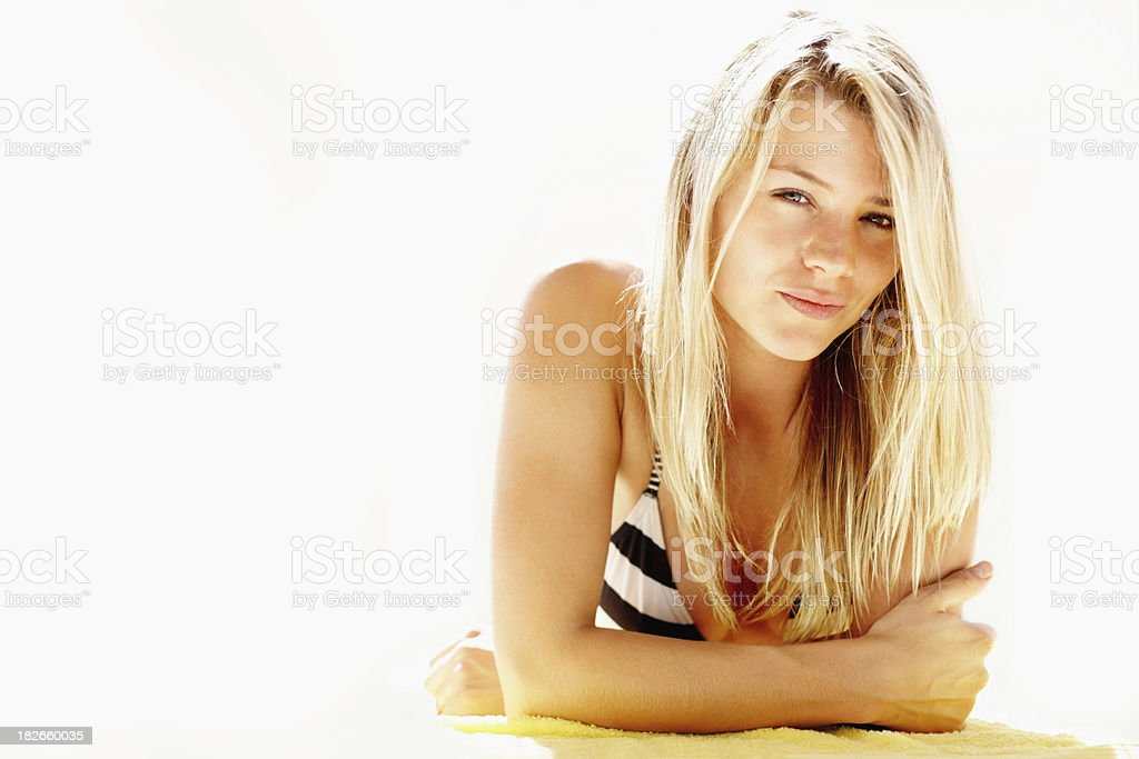 Young woman lying on a beach towel royalty-free stock photo