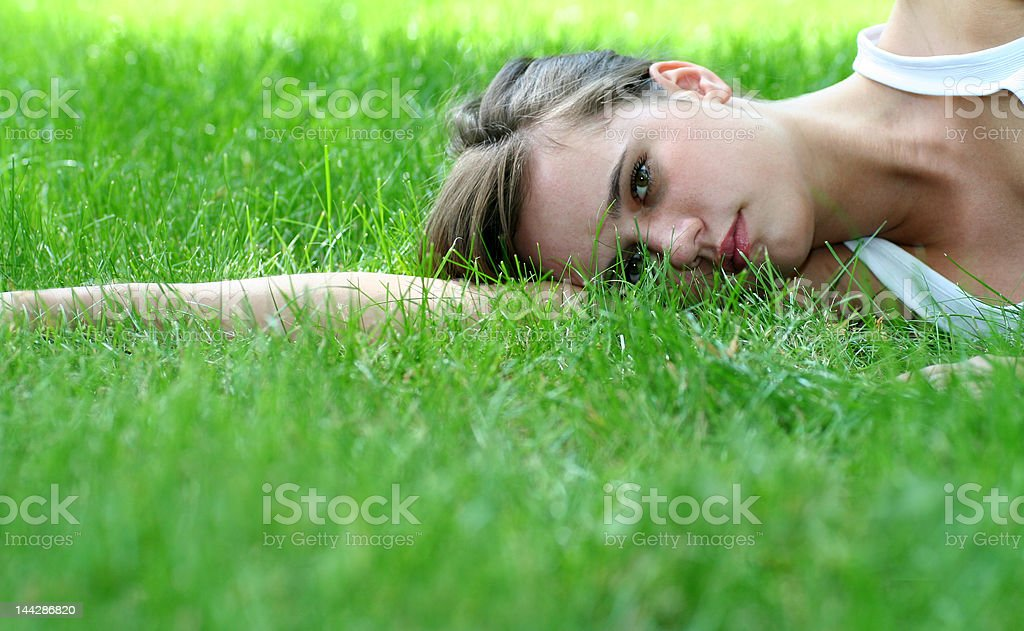 Young woman lying on a lawn royalty-free stock photo