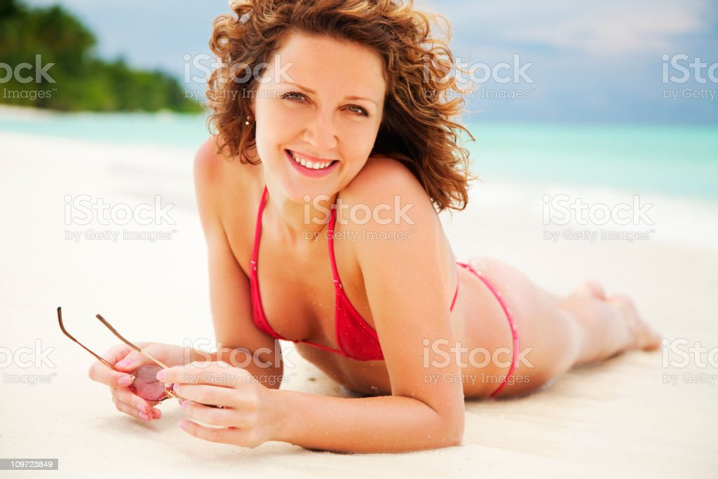 Young woman lying on beach royalty-free stock photo