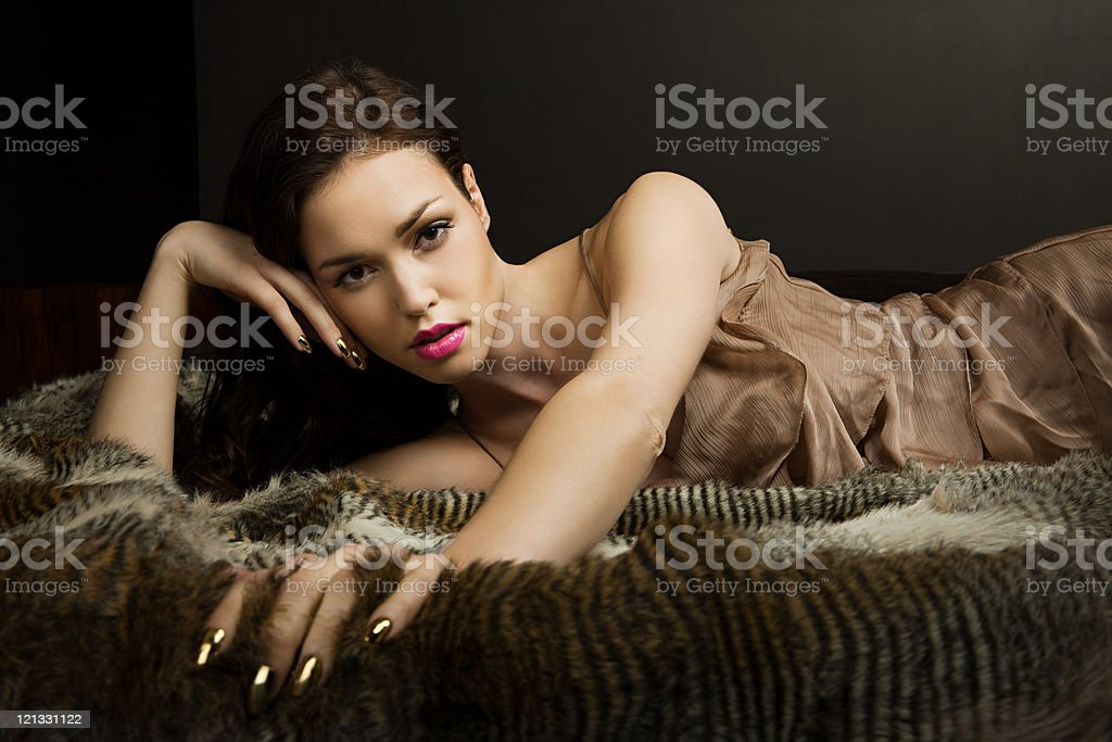 Young woman lying on blanket, portrait royalty-free stock photo