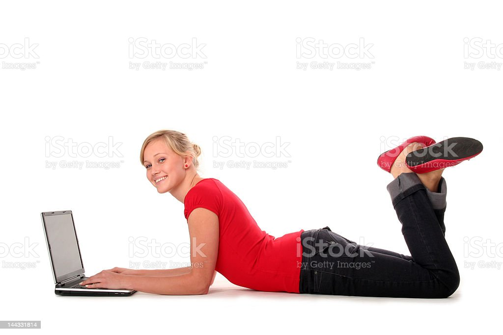 Young woman lying on floor using laptop royalty-free stock photo
