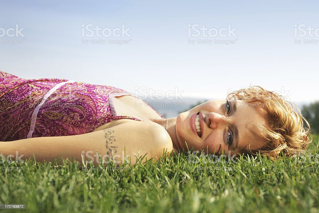 Young woman lying on grass II royalty-free stock photo