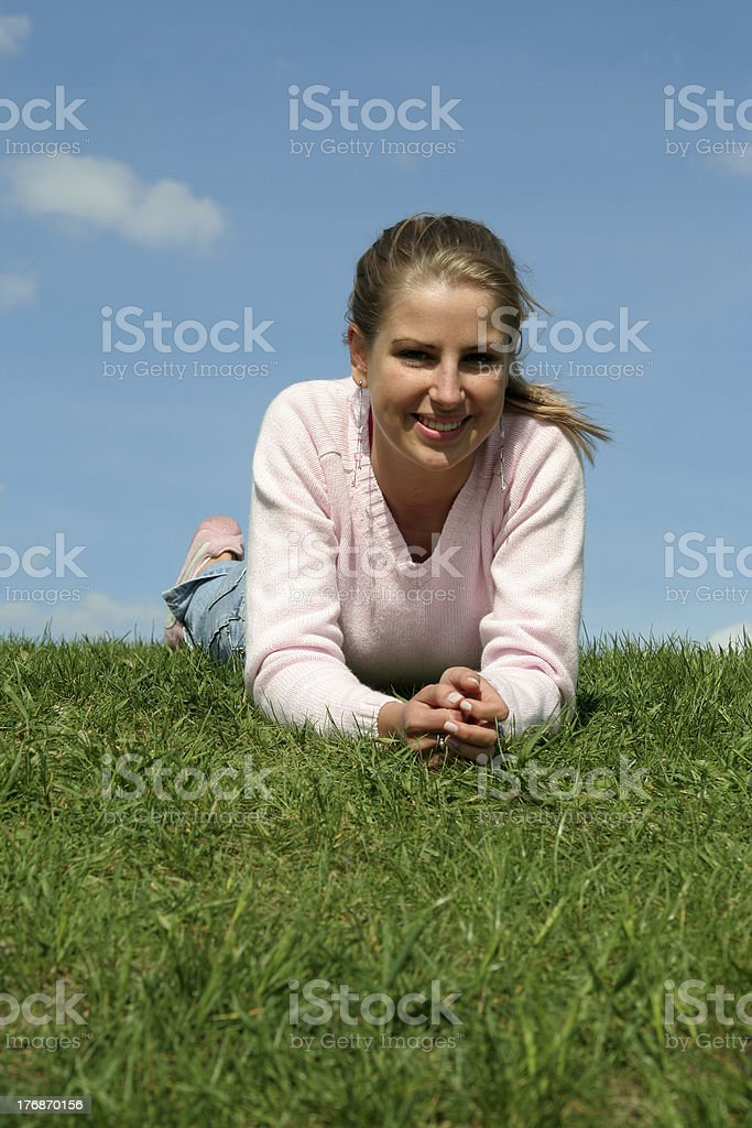 Young woman lying on grass royalty-free stock photo