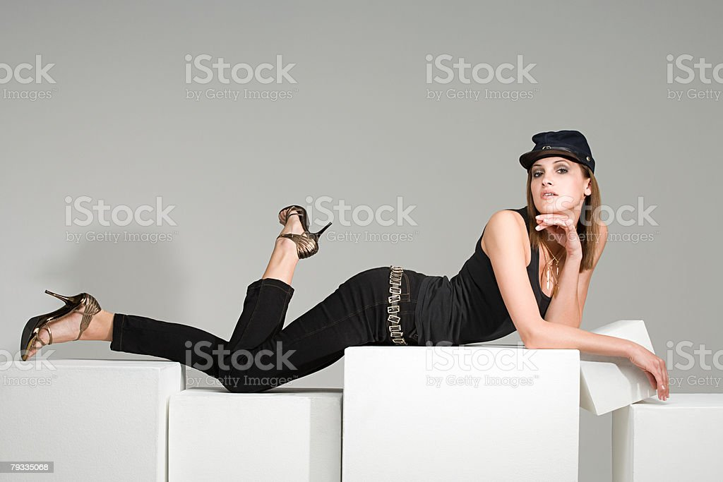 Young woman lying on top of boxes stock photo