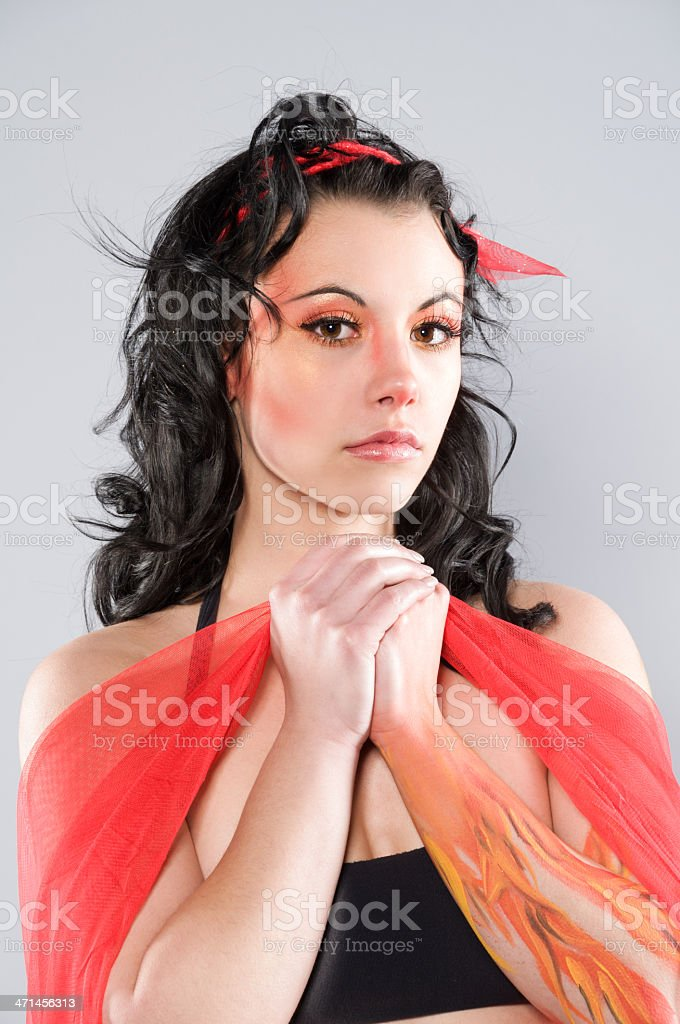 Young woman made up as fire nymph royalty-free stock photo