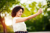 Young woman make a fun selfie on phone