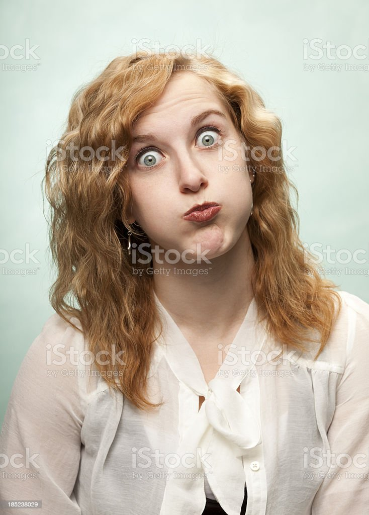 Young Woman Makes a Funny Face stock photo