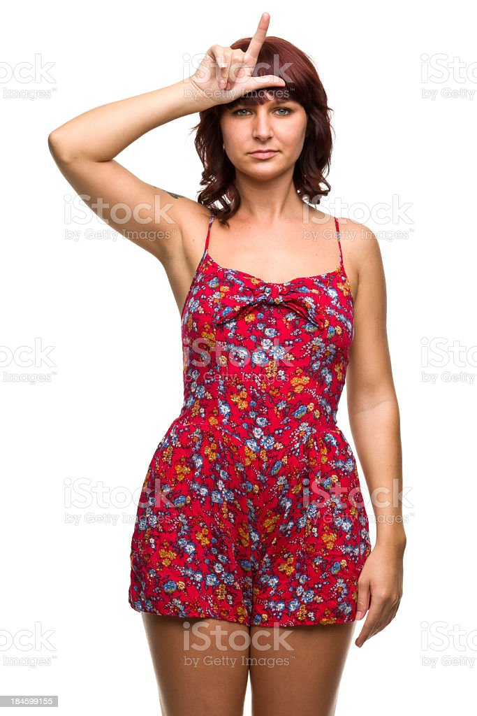 Young Woman Makes Loser L Hand Gesture royalty-free stock photo