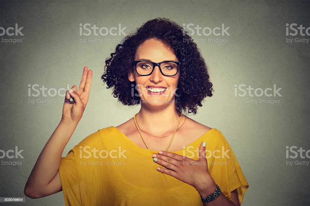 Young woman making a promise stock photo