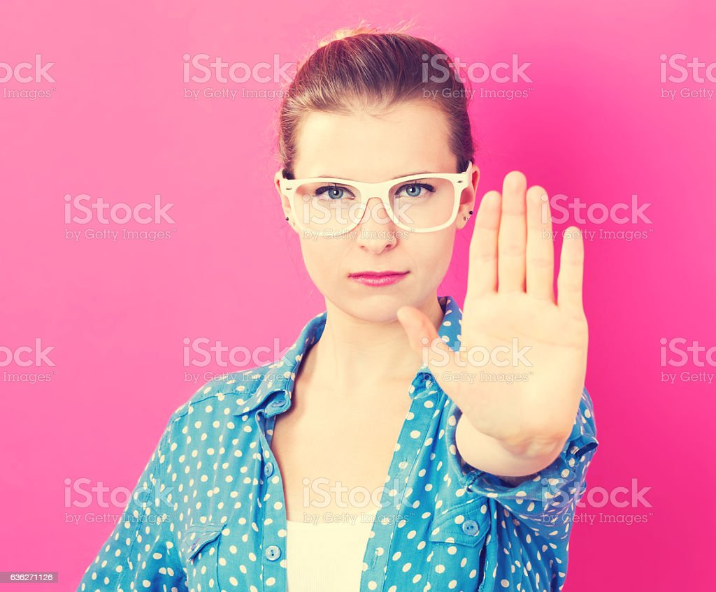 Young woman making a rejection pose stock photo