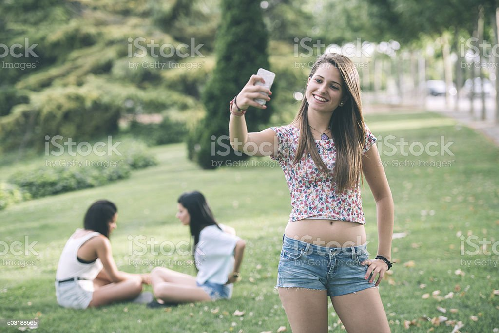 Young woman making a selfie stock photo