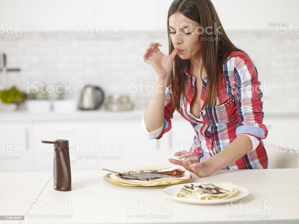 Young Woman Making Crepes In The Kitchen royalty-free stock photo