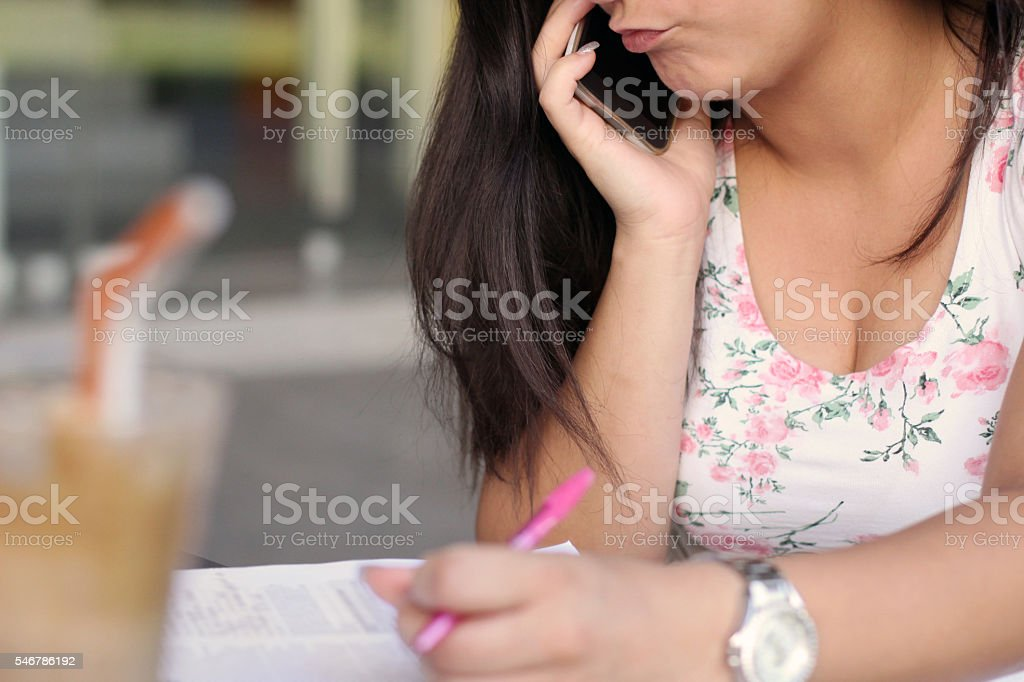 Young woman making faces on the phone stock photo