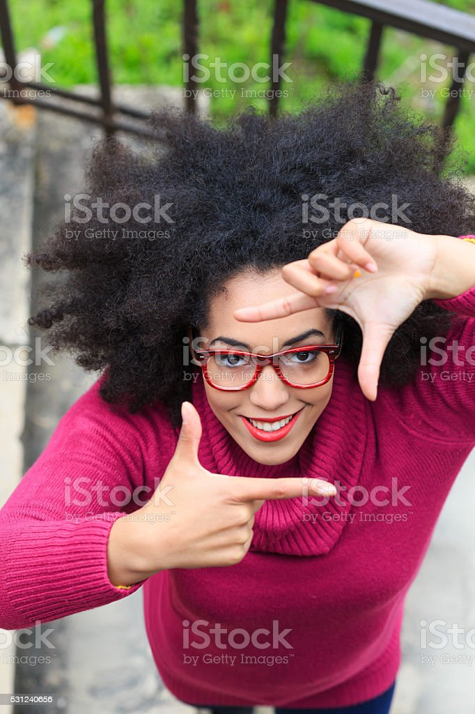 Young woman making finger frame stock photo