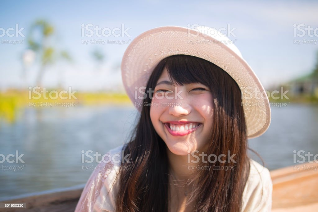Young woman making full of smile on sightseeing boat stock photo