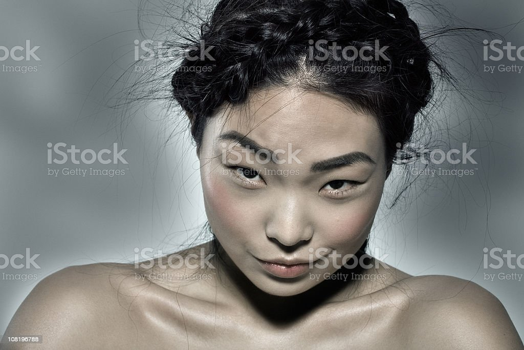 Young Woman Making Ironic Facial Expression royalty-free stock photo