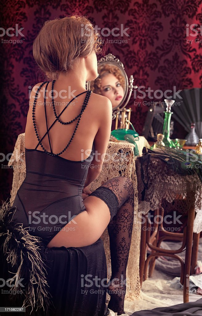 young woman making make up royalty-free stock photo