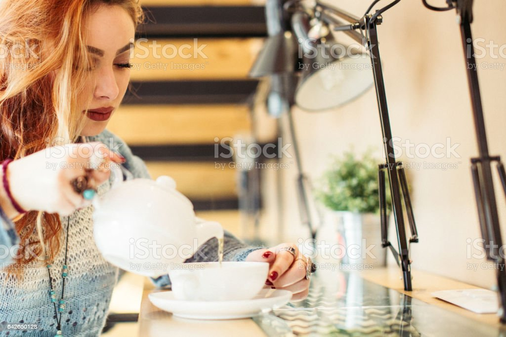 Young woman making tea stock photo