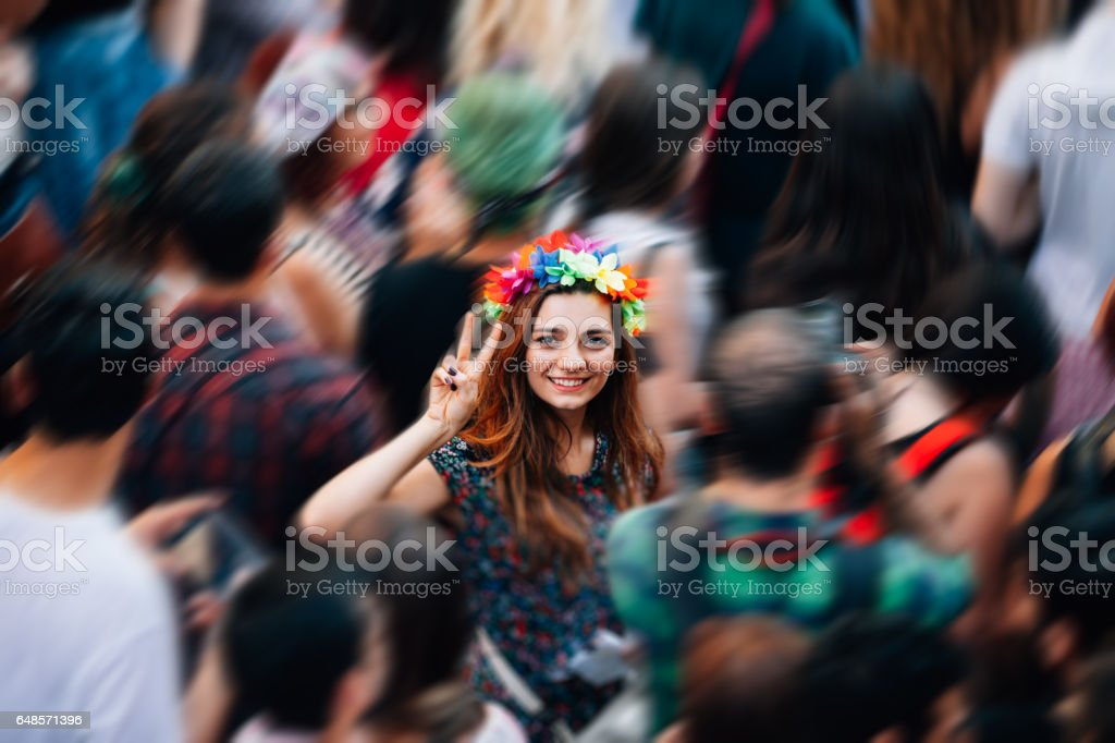 Young woman making victory sign with hand enjoying the protest stock photo