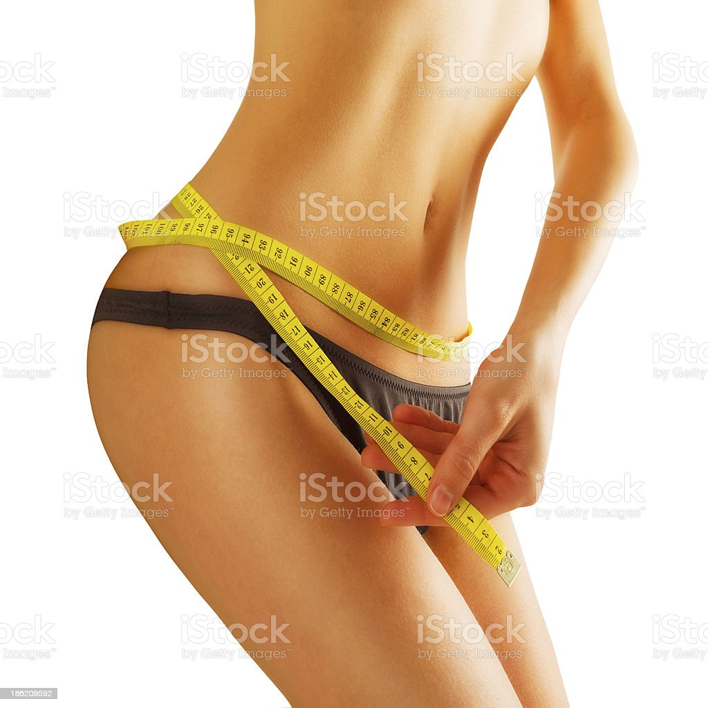 young woman measures the waist royalty-free stock photo