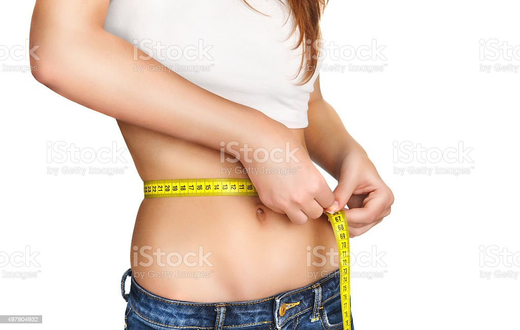 Young Woman measuring her waist. stock photo