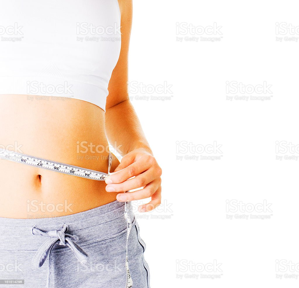 Young Woman Measuring Herself On White royalty-free stock photo