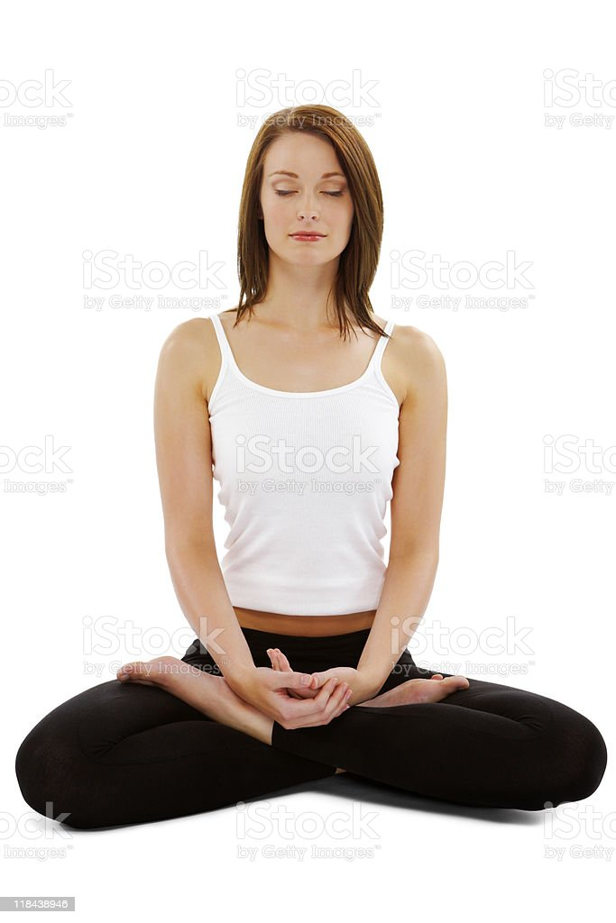 Young woman Meditating in seated position on white background stock photo
