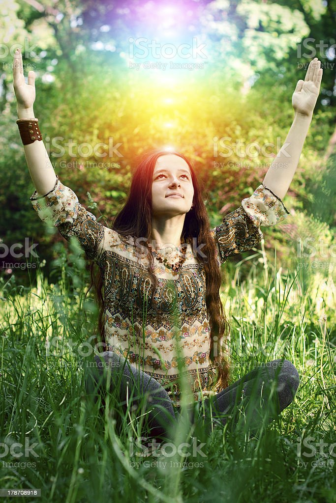Young woman meditating in the garden stock photo