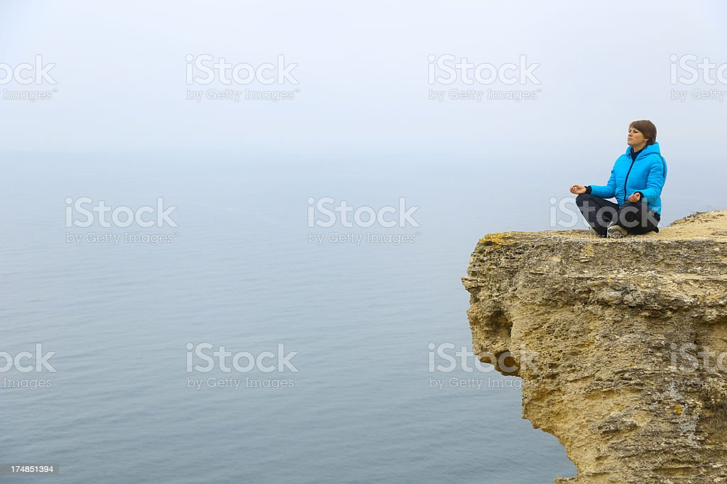 young woman meditating royalty-free stock photo