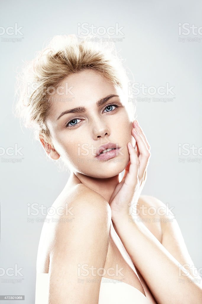 Young woman model posing on a gray background stock photo