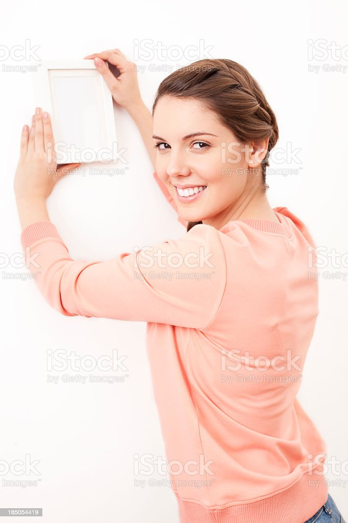 Young woman moving house having fun royalty-free stock photo