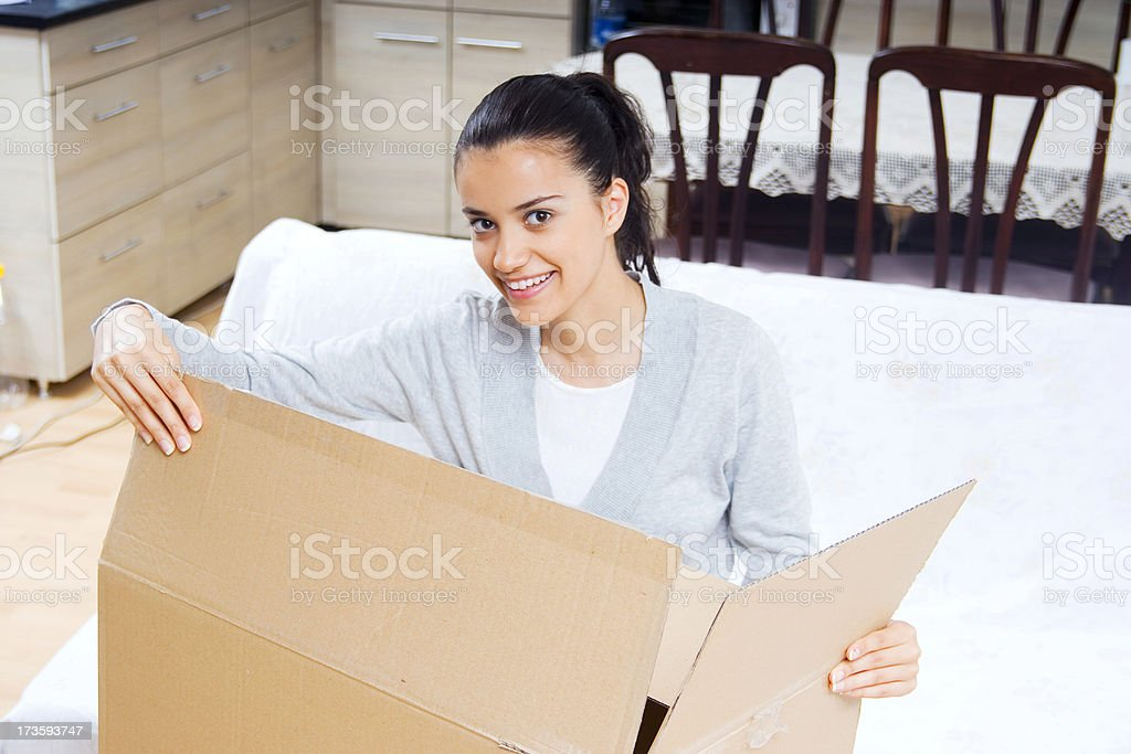 young woman moving in hew house royalty-free stock photo