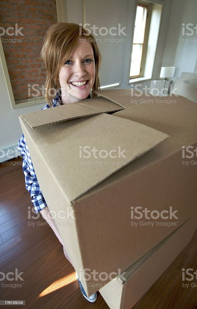 Young Woman Moving In stock photo