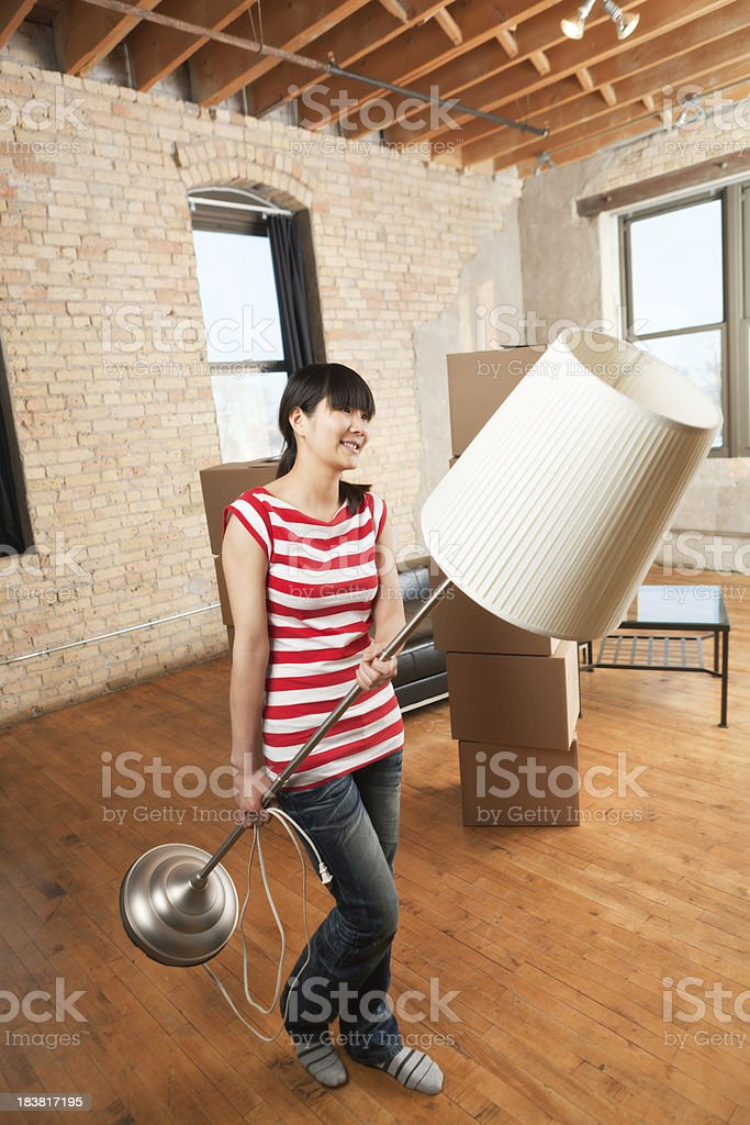 Young Woman Moving Into Loft Condominium Apartment Home Vt royalty-free stock photo