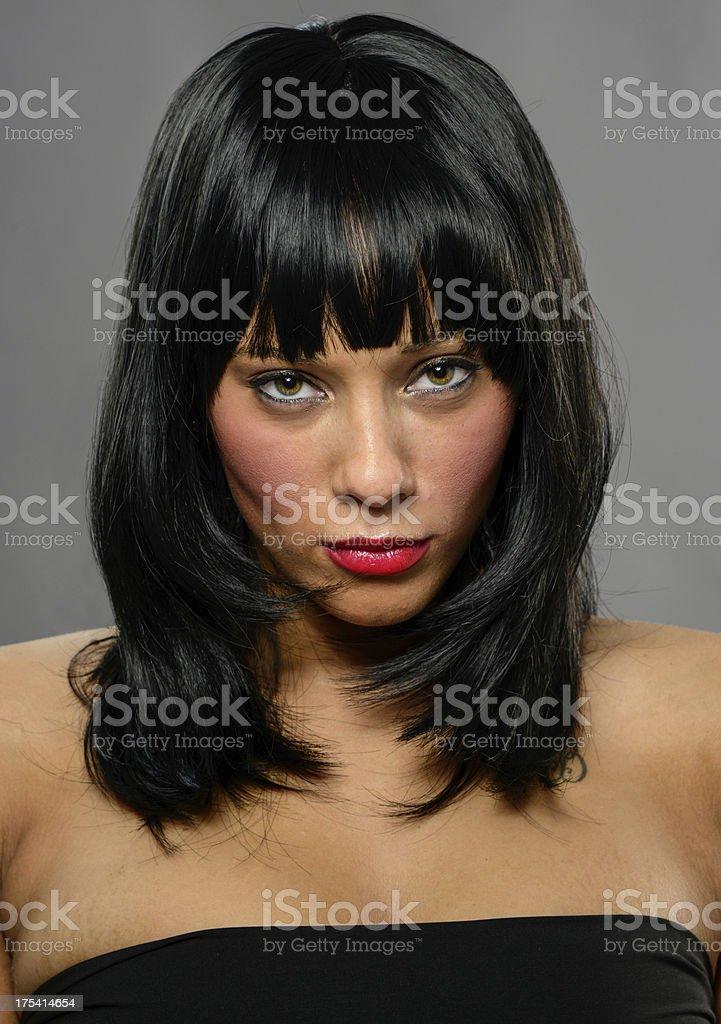 Serious Young Woman Mug Shot on Gray Background