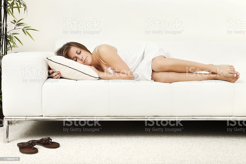 Young Woman Napping on Couch stock photo